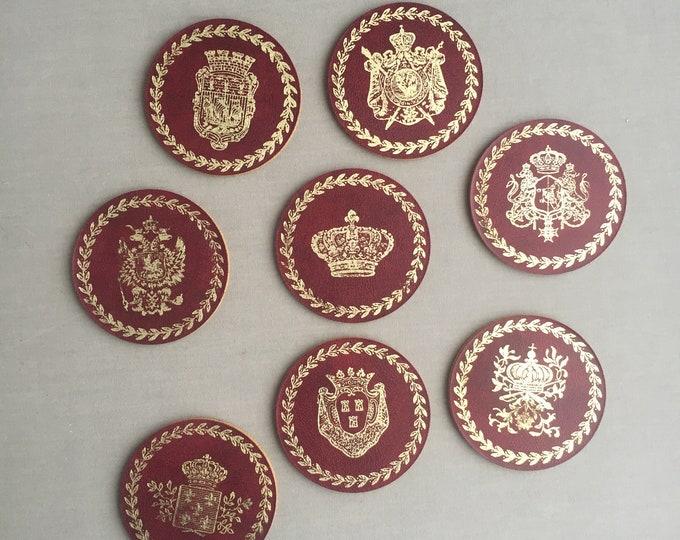 vintage gilt embossed Swedish coat of arms coasters