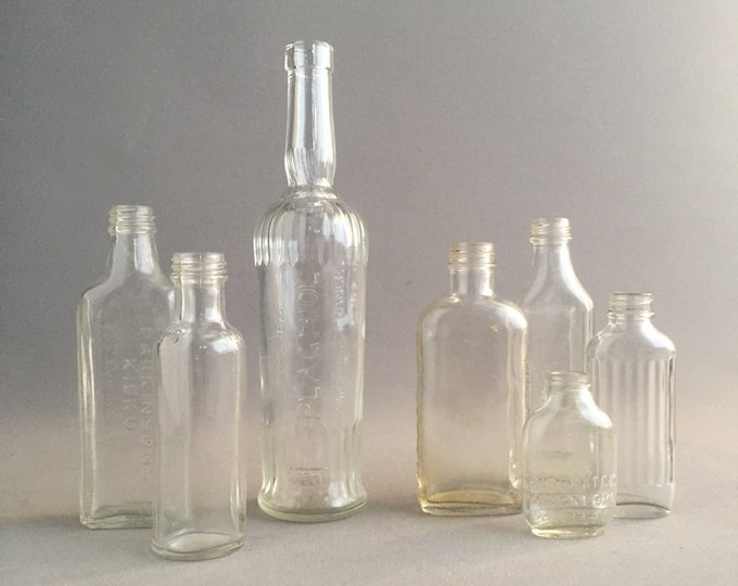 collection of old medicine bottles