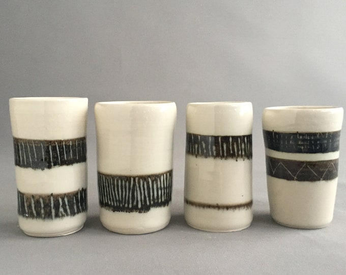 hand made ceramic vessels cups/ vases