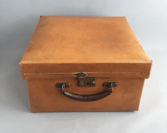 Vintage hat box suitcase with key