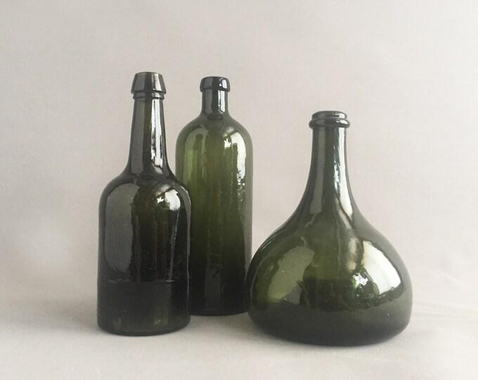 3 old green glass bottles