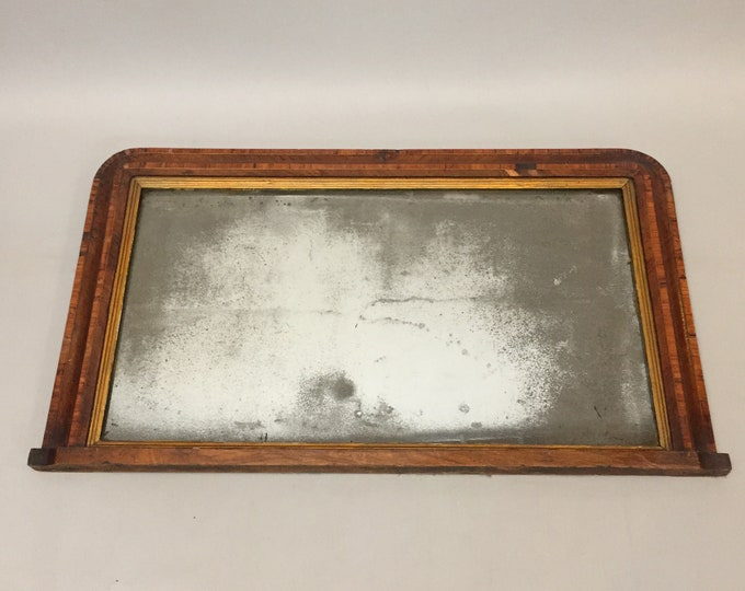old foxed  mirror in old wood frame
