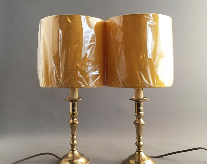 pair of little brass lamp stands with mustard yellow linen lampshades