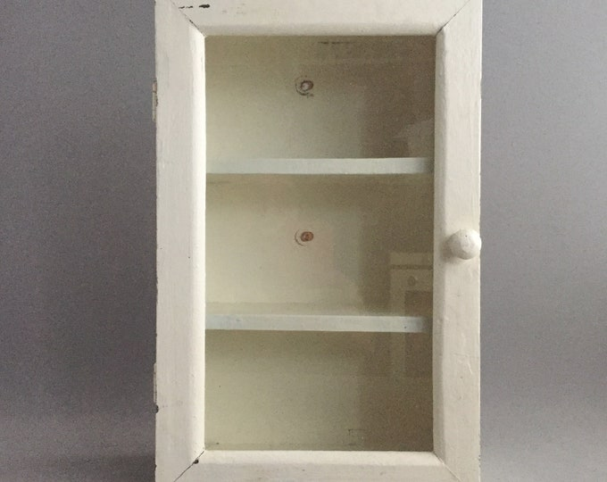 little painted wooden cabinet
