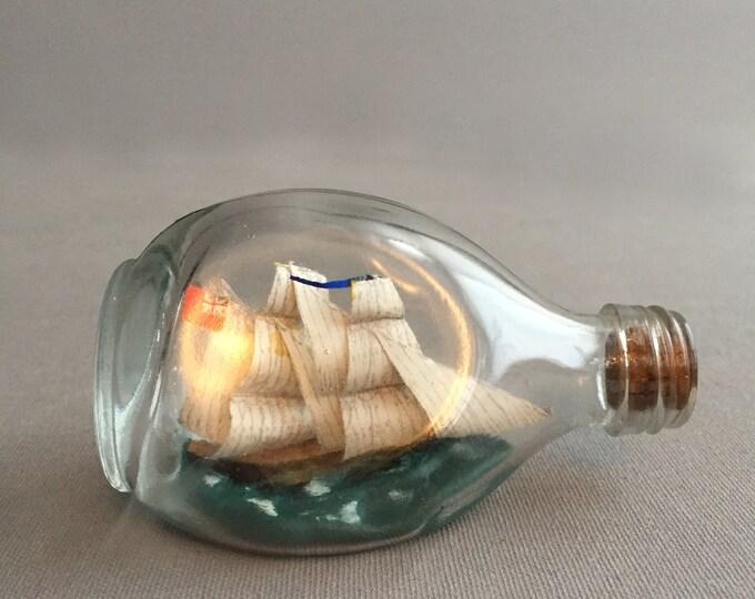 Little ship in a bottle