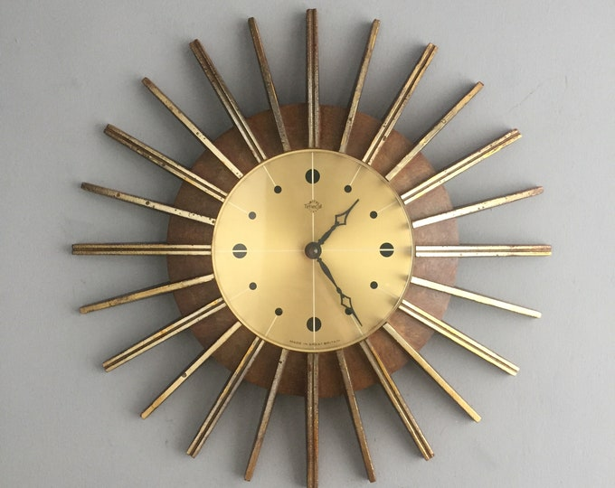 sunburst clock 1960s by Timecal ( smiths) England