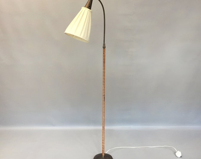EINAR BÄCKSTRÖM, a brass and leather 1950's floor light