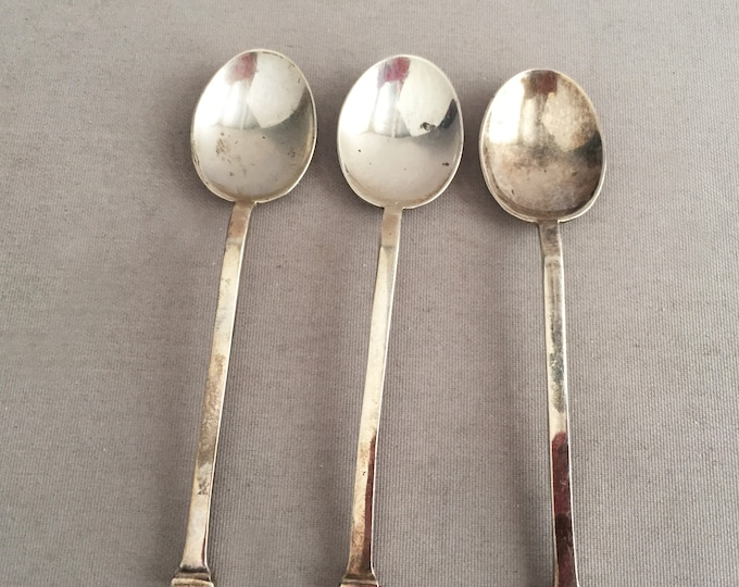 3 small silver spoons