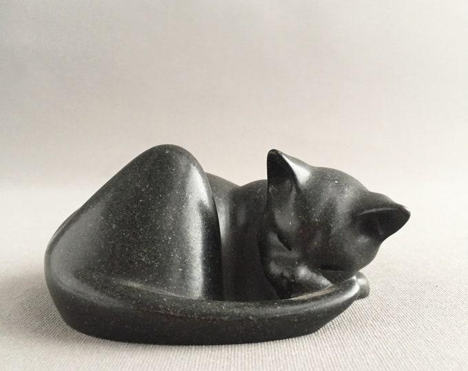 A Capella of Dartington sleeping cat figure, signed S. Marsh.