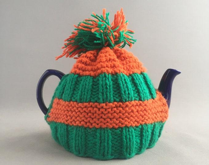 wool tea cosy and ceramic tea pot