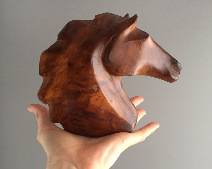 carved wooden horse head sculpture