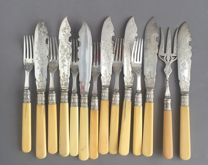 old fish cutlery set and serving utensils