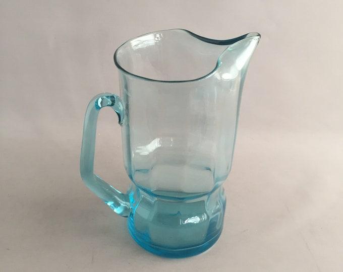 light blue large glass jug