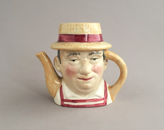little china tea pot- butcher / baker