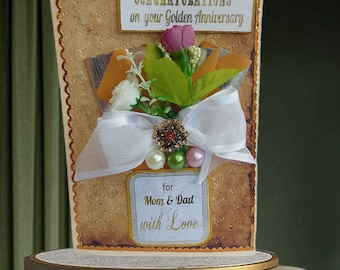 Celebration card for Mom and Dad. Personalized, 50th Anniversary card with a bouquet, pearls and brooch.  Luxury, Milestone Wedding card.