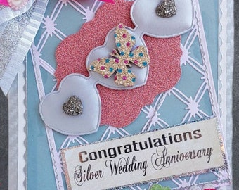 Personalized, Silver Wedding Day card with hearts and roses. Luxury Anniversary card with 2 brooches, pearls and ribbons. 25 milestone card.