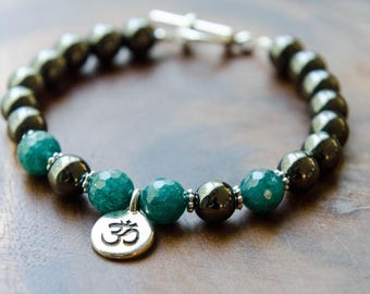 Hematite and Faceted Aquamarine Grounding Bracelet with Om Charm