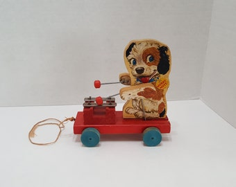 3f7a53d69c9 1950s Fisher Price Merry Mutt Musical Dog Pull String Toy