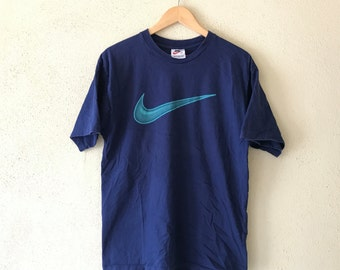 0c9fe6f5 Vintage 90's NIKE Swoosh tshirt Big Logo Spell out hip hop swag navy blue  Colour medium size