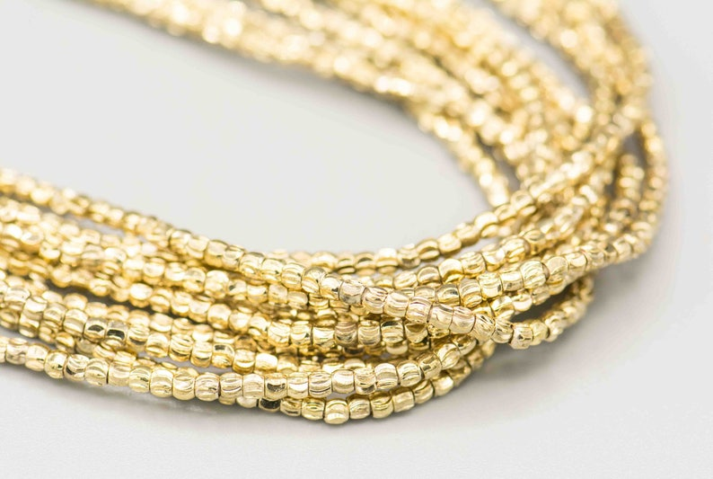 Tiny Crescent Faceted 2x2.2mm Golden Brass Beads 280 on 22 Strand MB-1-G