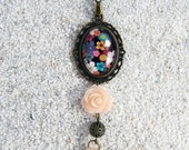 "Long necklace, oval medallion cabochon, pearls decorated and pompom,models ""Mai Linh""- Design ' Black small flowers design"
