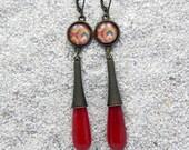 Long drop earrings, round...