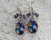 """Long earrings, oval cabochon and knot- model """" Rose"""" - Rose on Blue background print"""