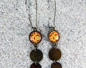 """Long, hanging sleepers earrings with cabochon and metal medallions, color old-looking brass - Model """"Lucie""""  Yellow Wax design"""