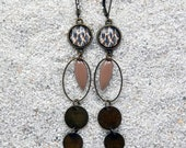 "Long sleepers earrings , oval hoops, round cab and enamelled charms - Design Wildcat skin - Model ""Eugénie"""