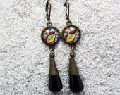"""Long Earrings, small round cabochon, metallic charm, cat's eyes effect beads- model """" Chloé """"  Black africa wax design"""