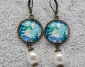 """Sleepers earrings,design """"Monstera deliciosa turquoise leaves"""",antic brass metal,cabochons and beads, model """"Caroline"""""""