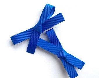 Pair of ribbon school bows.