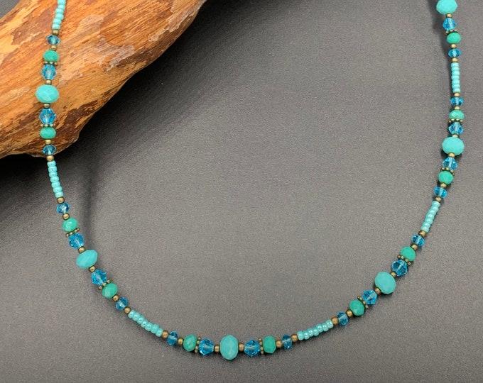 Short handmade beaded necklace. With Hamsa hand of Fatima pendant.