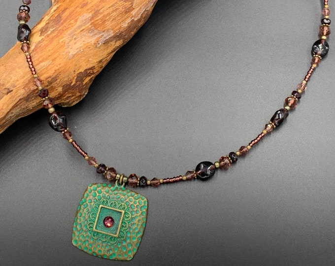 Short handmade necklace made of Bohemian glass beads.