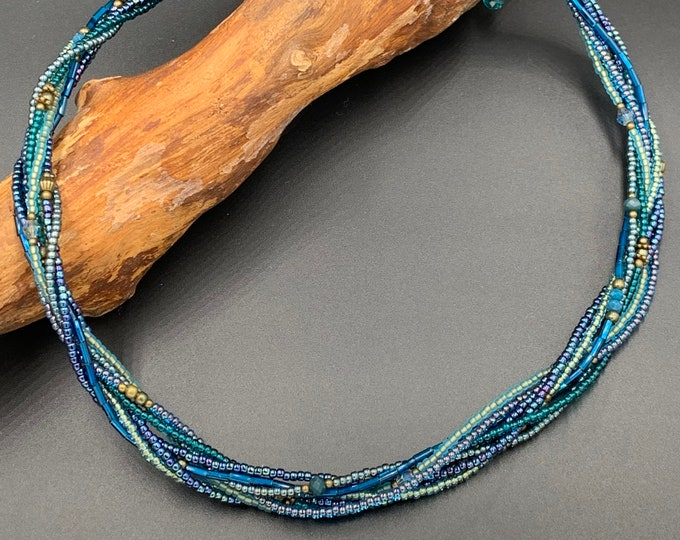 Short handmade beaded necklace made of toho beads.