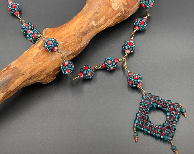 Long handmade ball necklace made of toho beads with pendant