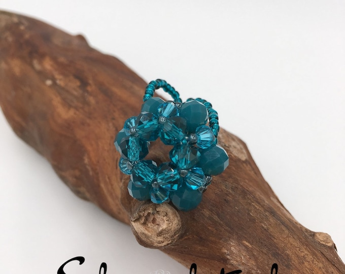 Handmade beaded ring made of Toho beaded ring and glass beads.