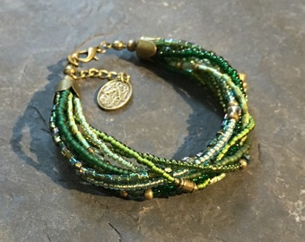 Handmade Beads Bracelet made of Toho beads. More colours to choose from. With Hamsa hand of Fatima pendant.