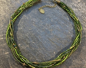 Short hand made beads necklace of Toho beads. With Hamsa hand of Fatima pendant.
