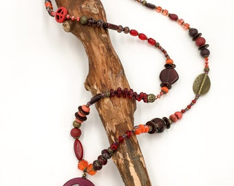 Handmade long beaded necklace made of Toho beads, glass beads and polymer clay (fimo) beads. With Hamsa hand the Fatima pendant.