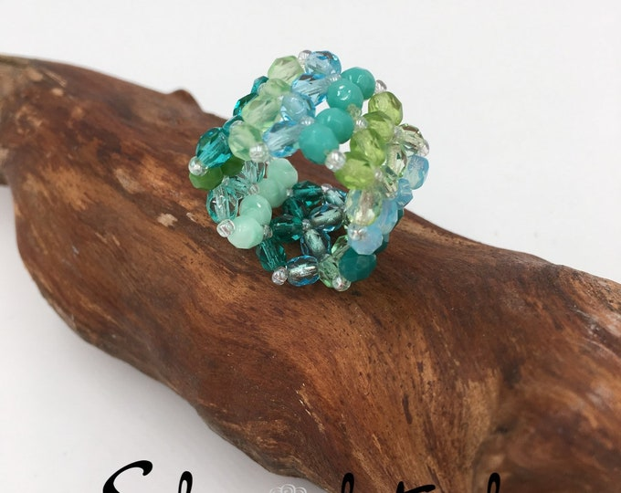 Handmade beaded ring made of Toho beads and glass beads.