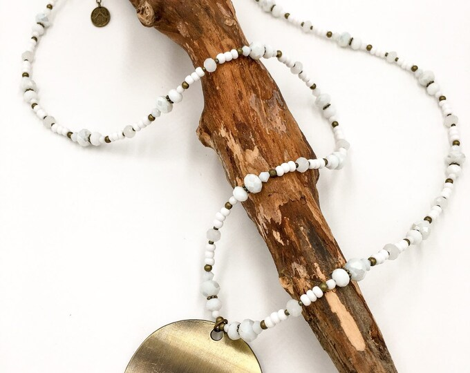 Handmade long pearl necklace made of Toho pearls in light blue. With Hamsa hand the Fatima pendant.