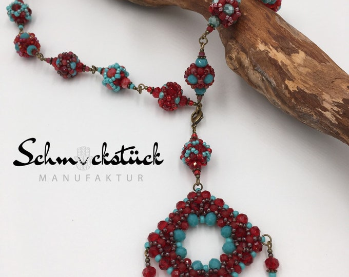 Short handmade ball necklace made of Toho beads. With Fatima-Hamsa-hand pendant.