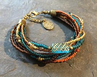 Handmade / handmade Beads Bracelet made of Toho beads. With Hamsa hand of Fatima pendant.