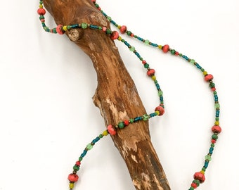 Handmade long pearl necklace made of Toho beads. With Hamsa hand the Fatima pendant.