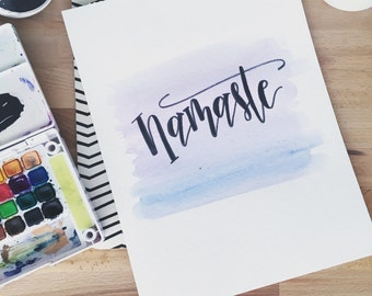 Hand lettered watercolor blue and purple Namaste painting. High quality watercolor paper.