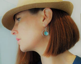 Sterling silver, light blue enameled earrings with suspended circle in hoop, hook on pieced  earrings.