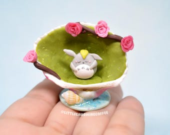 Sleeping Totoro in a Forest Shell