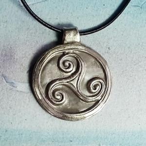 ona black leather strap copper Celtic unisex wicca pendant triskel hand made in  silver color bronze gold color bronze possible.