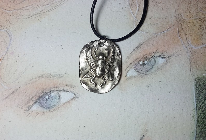 Unisex esoteric pendant Egyptian beetle handmade in silver-colored bronze also available in copper and gold-colored bronze  black leather